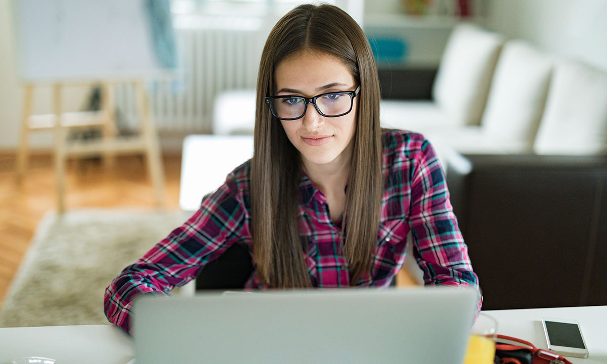 Girl looking at a laptop
